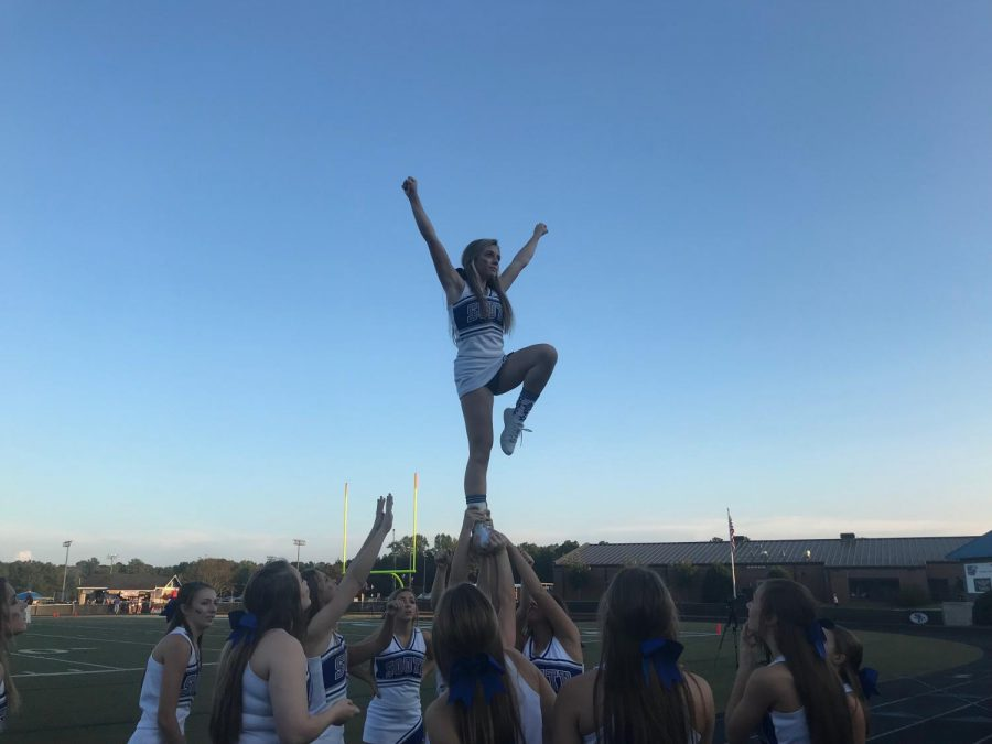 South+Forsyth%27s+cheer+squad+hoists+their+flyer+up+in+the+air+to+ramp+up+the+crowd+before+the+game.+The+cheerleaders+continued+to+support+the+War+Eagles+with+spirit+and+optimism+throughout+the+rest+of+the+game.+