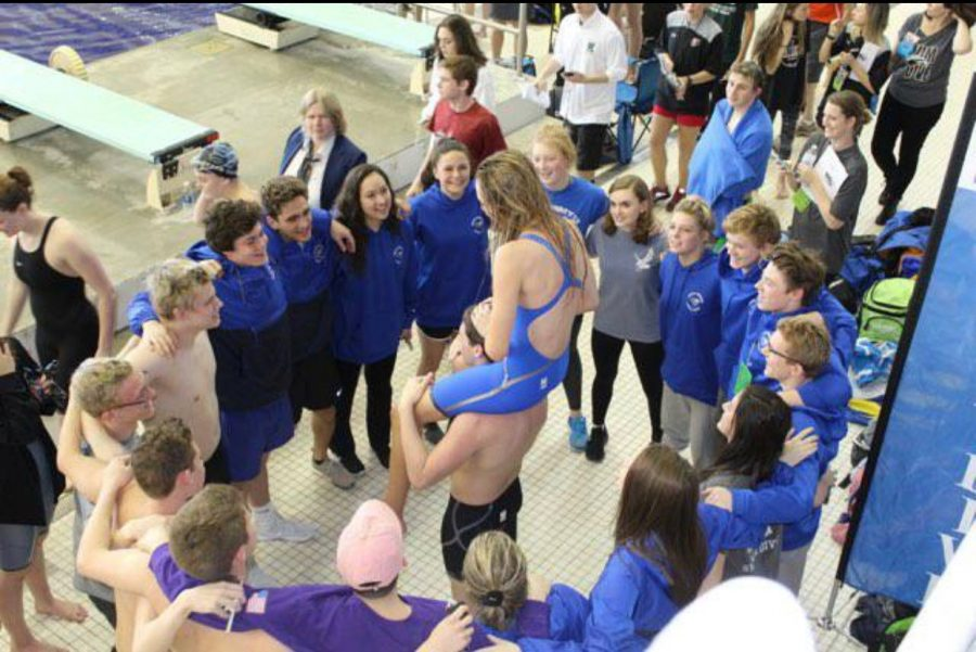 The+state+qualifiers+prepare+for+the+last+team+cheer+of+the+season.+
