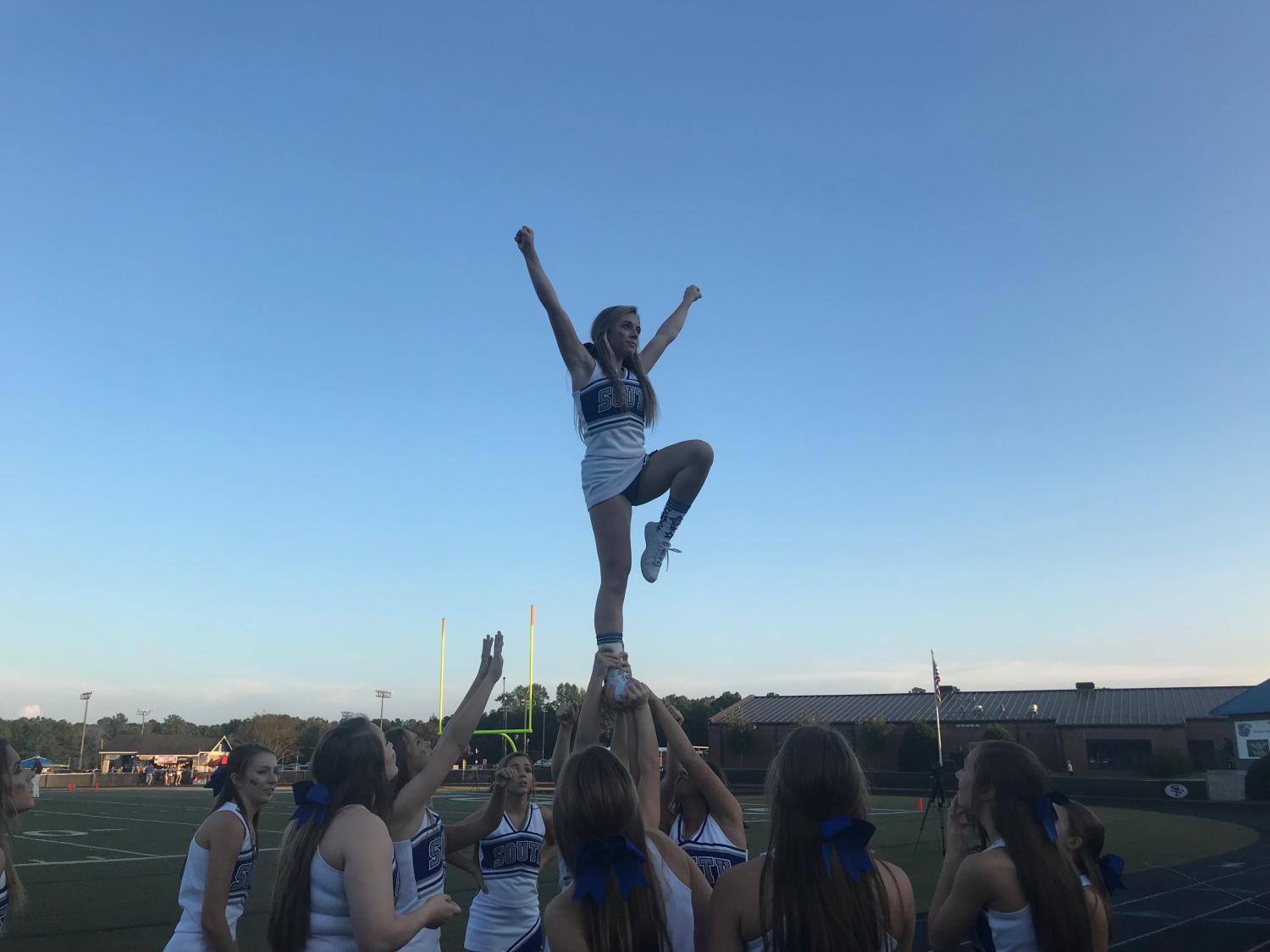 South Forsyth's cheer squad hoists their flyer up in the air to ramp up the crowd before the game. The cheerleaders continued to support the War Eagles with spirit and optimism throughout the rest of the game.