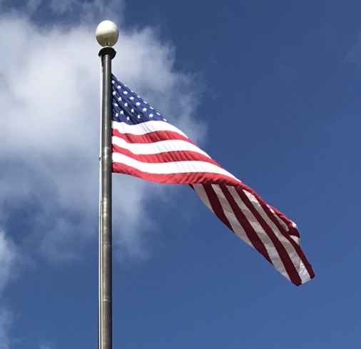 This is the American Flag, symbol of freedom. The flag stands in-front of West hall waving in the air, waiting to be saluted by the students of South.