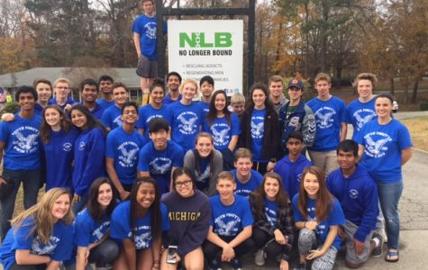 Swim and dive team gives back