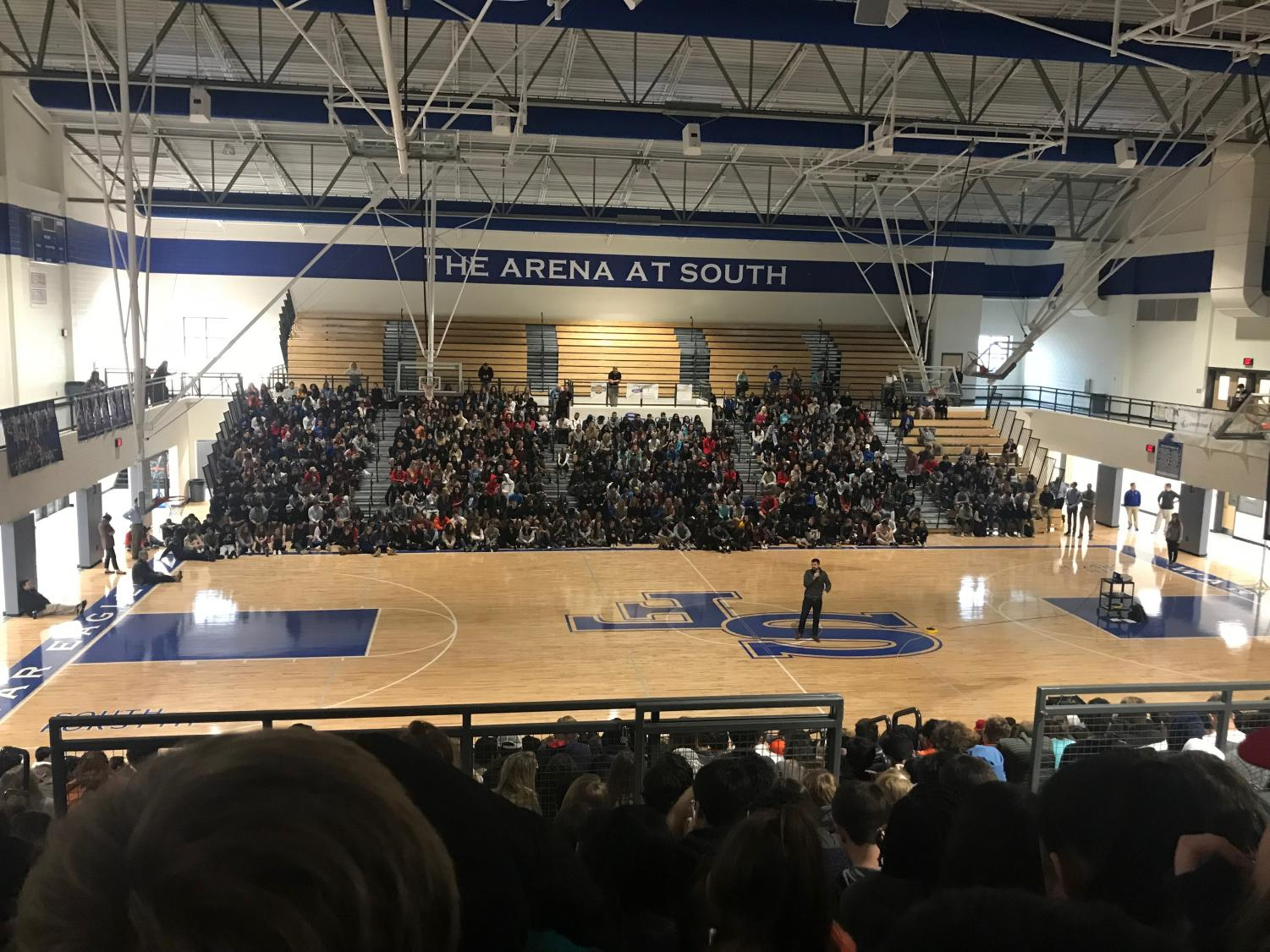 Speaker Logan Weber opens up his presentation about setting and reaching goals in South's Arena this morning. The Arena was packed with students, forcing the faculty to move the projector and screen  back and adjust the speakers' rotation.