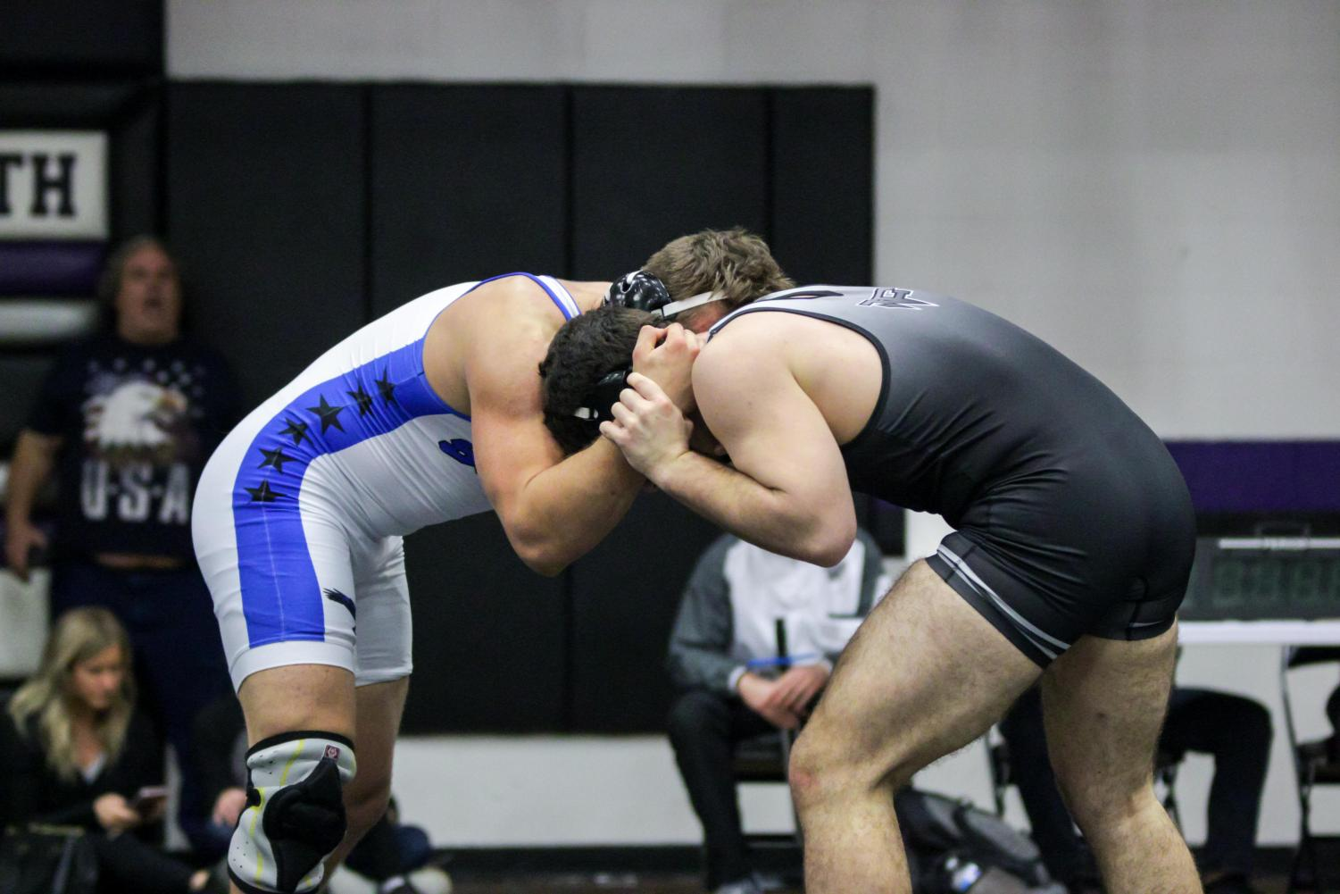 Wrestlers prepare to take on teams during the state tournament.