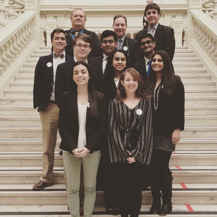 Students from South Forsyth High School attended AP Day at the Georgia State Capitol with teachers Mr. Pearre, Mr. Wolff, and Mr. Frilot. From Left to Right (3rd Row): Jack Slatton, Revanth Tiruveedhi, and Arjun Karanam; (2nd Row): Will Logsdon, Aashvi Patel, and Lahari Madineni; (1st Row): Emily Goncalves, and Chloe Nathan.