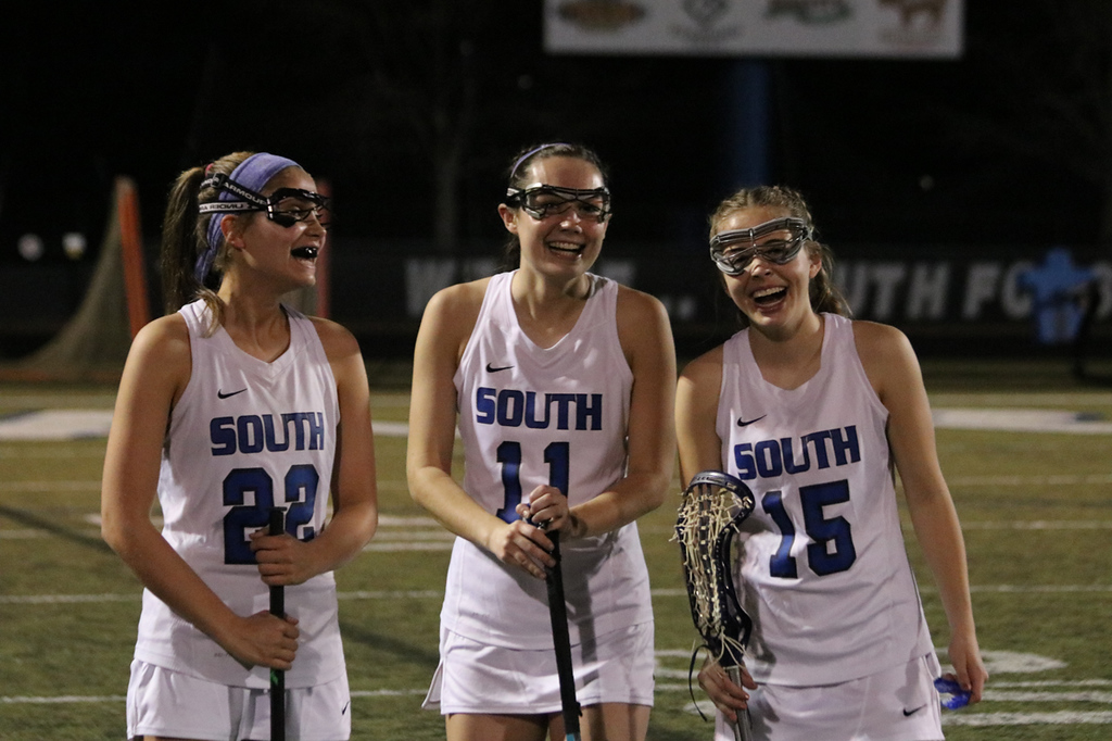 (From left to right: Lexi Kugelman, Morgan Hearn, Avery Wyckoff) The SFHS girls' lacrosse team prepares to start their game against Central.
