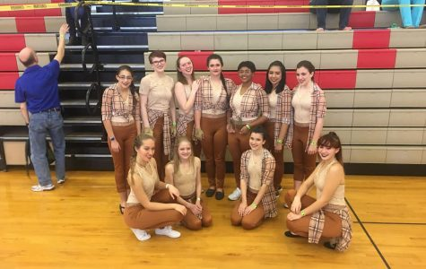 March 17, 2018 - The Winter Guard gather together for a group photo after winning 1st place at the Scholastic Regional A Class competition.