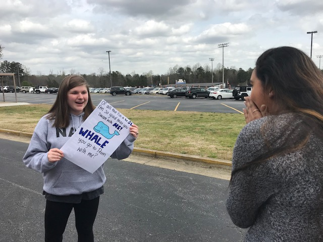 Lucy Taylor, left, asks Anvitha Bommineni, right, to Prom through a promposal saying