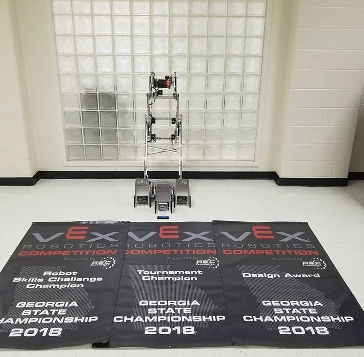 South's 1961U team created an impressive robot for their VEX State Competition. They were named the Robot Skills Challenge Champion (left), the Tournament Champion (center), and the Design Champion (right).