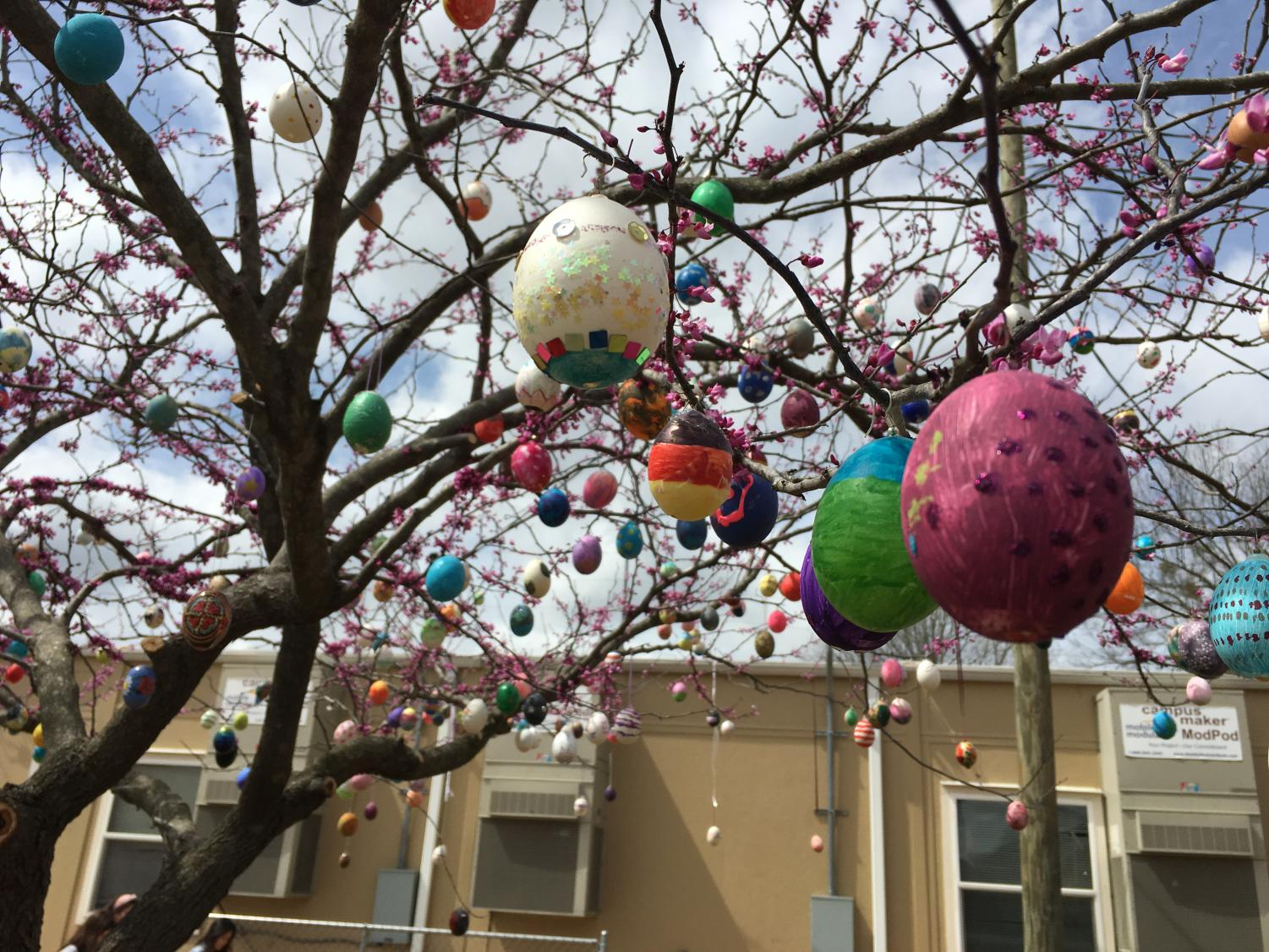 Despite the cold and windy weather, South's German Club kids set up their Tree of Life between the World Language Mod Pod and West Hall.