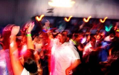 Young adults can be seen dancing the night away at a local party in Atlanta, in 2009. Bodies clashing and music blasting, accompanied with the fact that the picture is blurry, truly sets the seen for a classic high school party in Georgia.