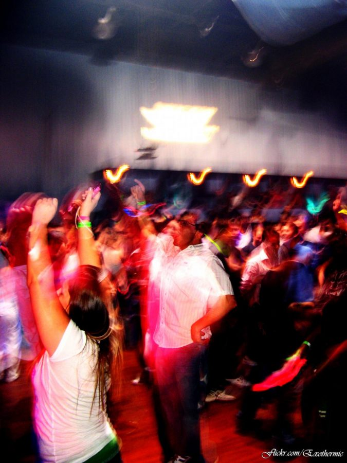 Young+adults+can+be+seen+dancing+the+night+away+at+a+local+party+in+Atlanta%2C+in+2009.+Bodies+clashing+and+music+blasting%2C+accompanied+with+the+fact+that+the+picture+is+blurry%2C+truly+sets+the+seen+for+a+classic+high+school+party+in+Georgia.