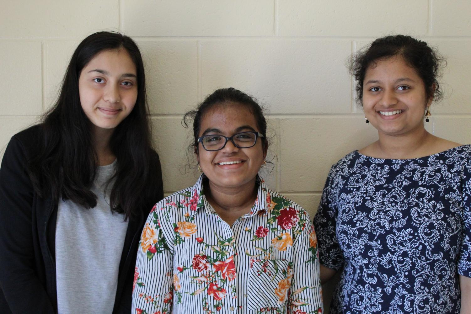 Three of the four founders of the recently new school club, Power in Words.
