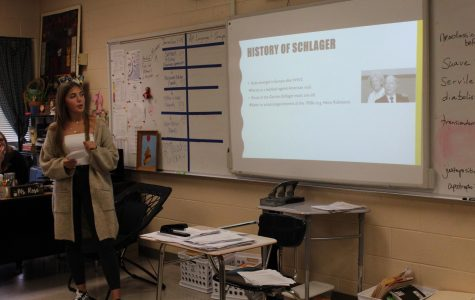 German foreign exchange, Lara Herrmann, gives a presentation to the journalism class on the popularity of Schlager Music in Germany.