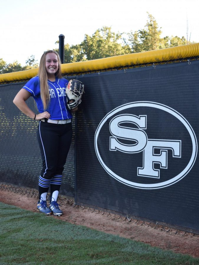 South and proud. Lauren Baccari stands in front of the South Forsyth High School logo, proud to be on the softball team. She has played softball since she was 4 years old, growing and improving in the sport ever since.