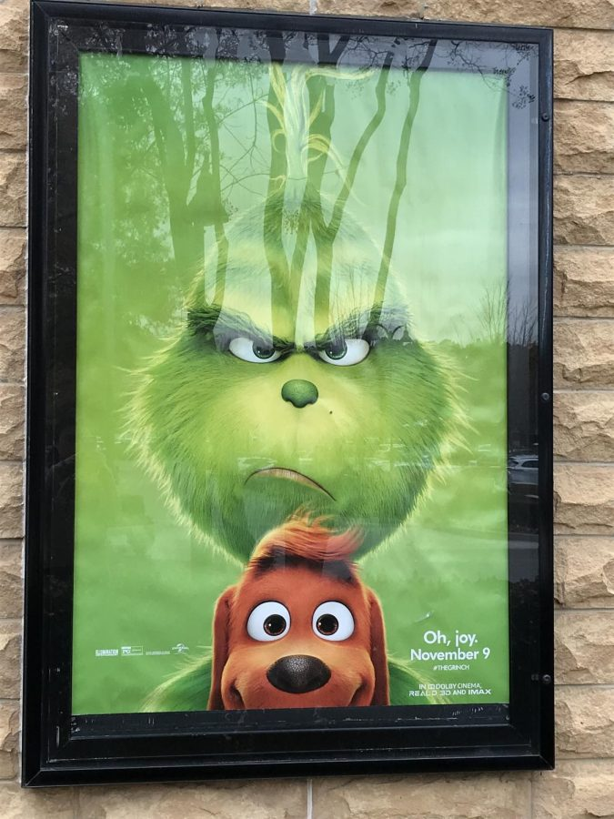 Grouchy Grinch. A movie poster advertising The Grinch hangs outside of AMC theaters at the Collection. The Grinch is the third adaptation of the beloved Dr. Seuss classic, How the Grinch Stole Christmas.