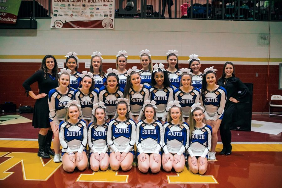 (From left to right: Coach Pileggi, Alexis Carvalho, Emory Hilton, Kalyn Vlasak, Jacquelyn Baker, Gaby Schauer, Cori Brustein, Coach Brawner, Katie Ireland, Mallory Mctyre, Jennifer Lucarelli, Abby Hallowes, Trinity Ford, Tori Watkins, Lily Cameron, Kendall Stephens, Sara Dougherty, Elizabeth Coffin , Sadee Sherrick, Kaylee Erneston and Sienna Rosin) The South Forsyth cheer team took on Regions and competed against four different schools; they placed 4th.