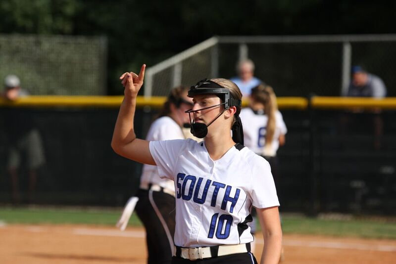 The+key+to+success.+Makenna+Segal%2C+a+talented+Softball+player+in+Forsyth+County%2C+uses+her+finger+to+send+a+signal+to+her+other+teammates.+Many+of+the+players+on+the+team+say+that+good+chemistry+and+communication+has+helped+them+win+games+against+other+schools%2C+like+North+Forsyth.