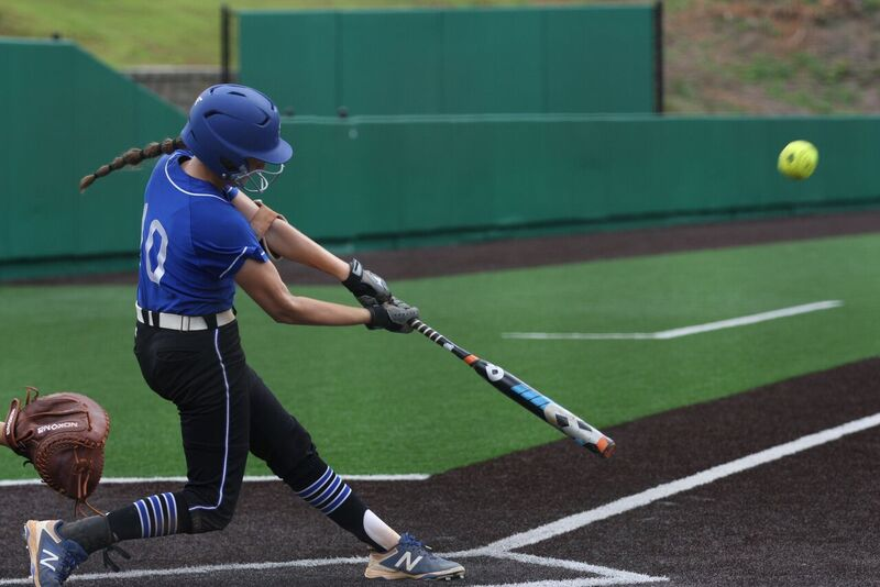 Eye on the ball. Makenna swings the bat with concentration, aiming to make an offensive play. Known for her offensive power, Makenna is seen as a threat to opposing teams.