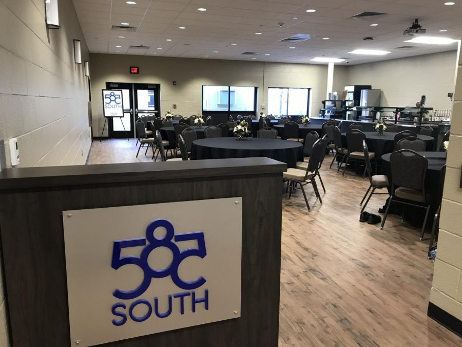 An empty room full of potential. 585 South will be the home of the new coffee shop. The room is filled with nice tables covered in tablecloths and comfortable chairs. Customers get the feel for a fancy restaurant while eating at 585 South.