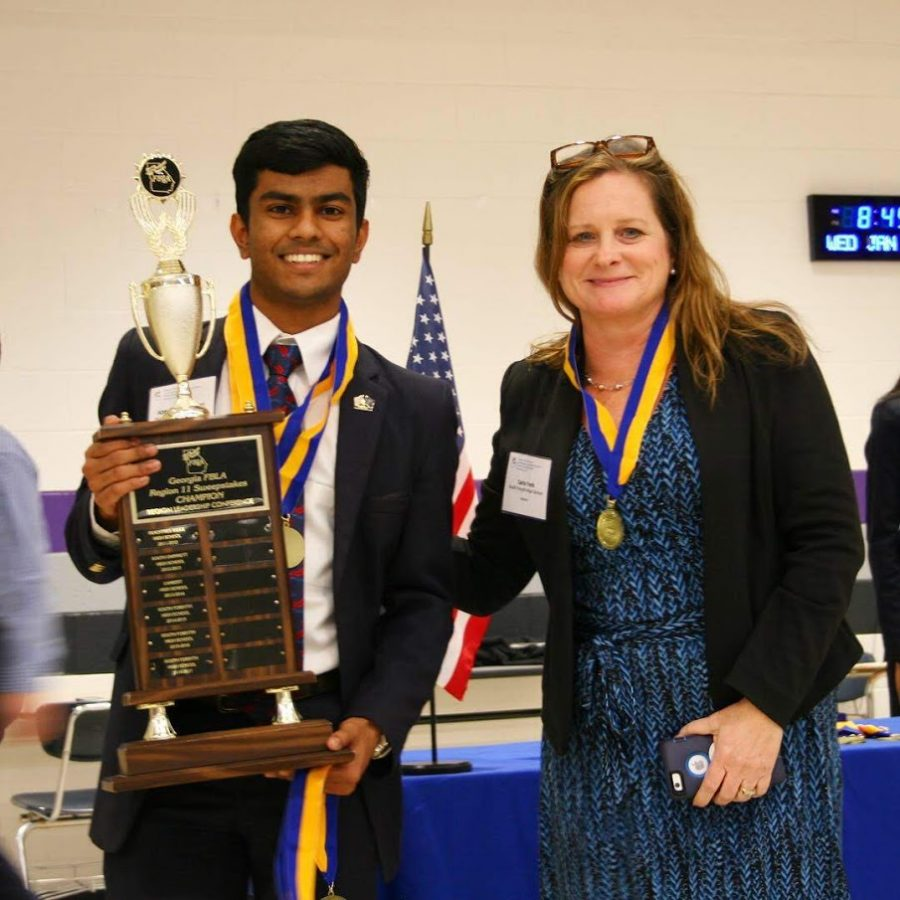 Medals in hand. Pictured is the president of FBLA, Abhay Chilakamarri, and the South Advisor for the club, Carla Yonk. They posed soon after Abhay received a first place award in his speaking event. Mrs.Yonk, an advisor at SFHS, speaks on the experience. She says: