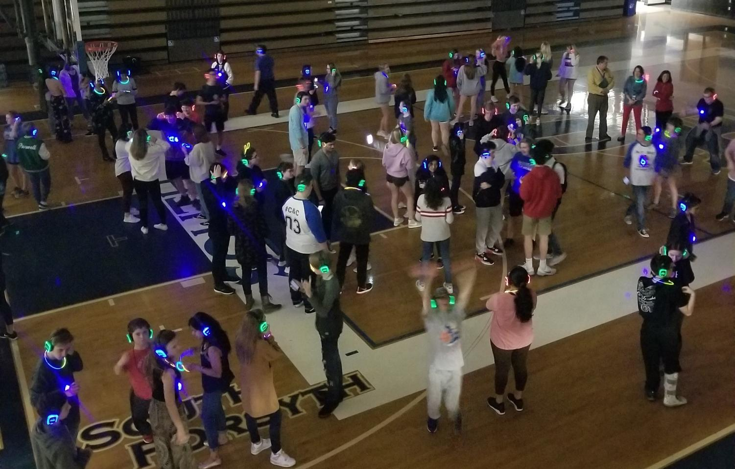 A sea of colors. Dream on 3 continues to raise funds for Carter and Carli, similar to the staff-student basketball game. The Silent Disco was the newest fundraiser for Carter and Carli's dream, and hundreds of students attended to jam out.