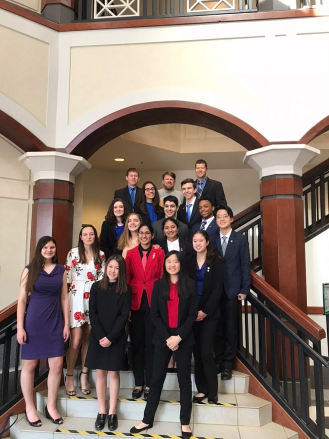 Defense and plaintiff at court. The South Forsyth Mock Trial Team stand together on the courtroom stairway steps for a group photo. They recently received news of winning third place in district and will start preparing for the district round.