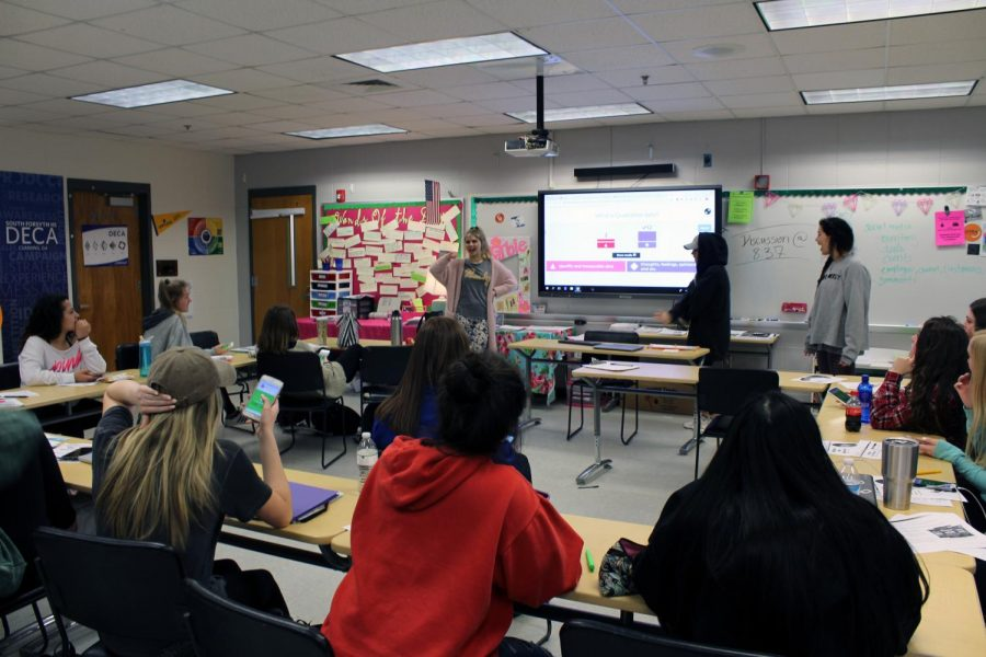 Students becoming the teachers. In this class, students can be shown speaking to their peers. Groups of students created a lesson and review quiz for the rest of their class. This involved the entire class in a way that connected students through academic discourse.
