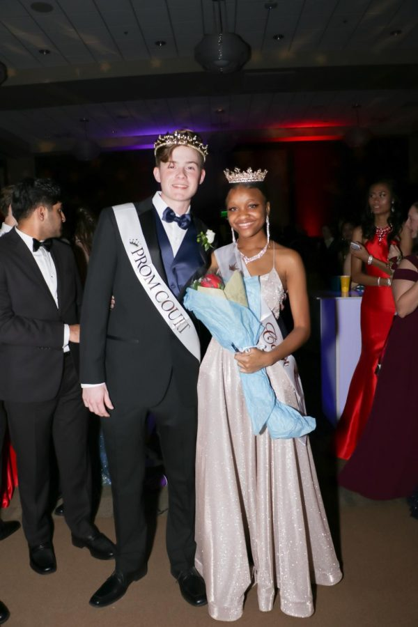 Posing+for+a+royal+photograph.+Matthew+Tesvich+and+Kiera+George+stand+side-by-side+after+accepting+their+titles+as+Prom+King+and+Queen.+Both+didn%27t+expect+to+receive+the+honor%2C+but+were+happily+surprised+for+the+rest+of+the+evening.
