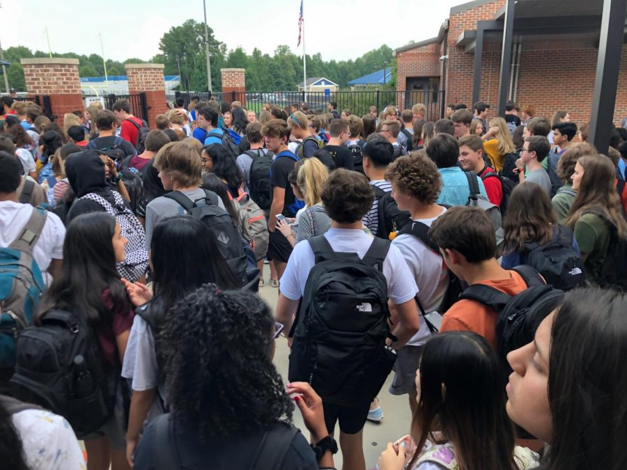 Refreshing into the new year. Before the time came to go home, students and teachers gathered outside to enjoy an icy popsicle to cool off their amazing day. As friends and faculty conversed, the social was energized with current and trendy music.