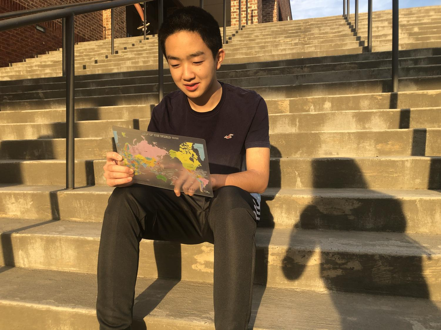 Traveling the globe.  Freshman Takumi Otani looks at a map in wonder of where he'll end up next. Considering all the places he has traveled already, his life is full of new adventures and discoveries.