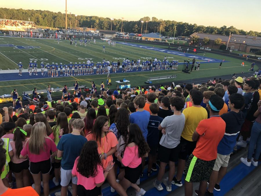 Shining Bright. After a day in neon, South students fill the stands with their brightly colored outfits to cheer on their favorite team.