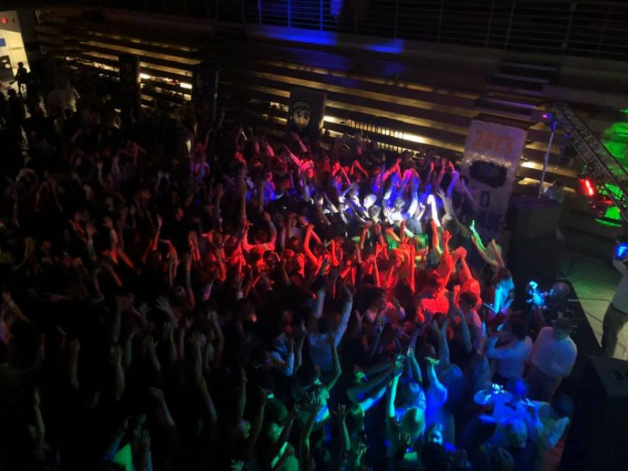 An enchanted night. Students from the SOFO student body gathered in the blue gym for the dance. Everyone danced and sang to the trendy music all night.