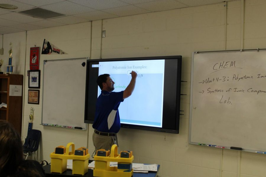 Ionic demonstration. Mr. Steele, a chemistry teacher, uses his ClearTouch board to teach. Throughout the school, a variety of styles lives within the teachers.