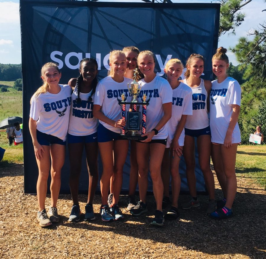 Girls team gathers around. On August 24, Saturday, South wins 3rd place at Saucony Battle of Atlanta.