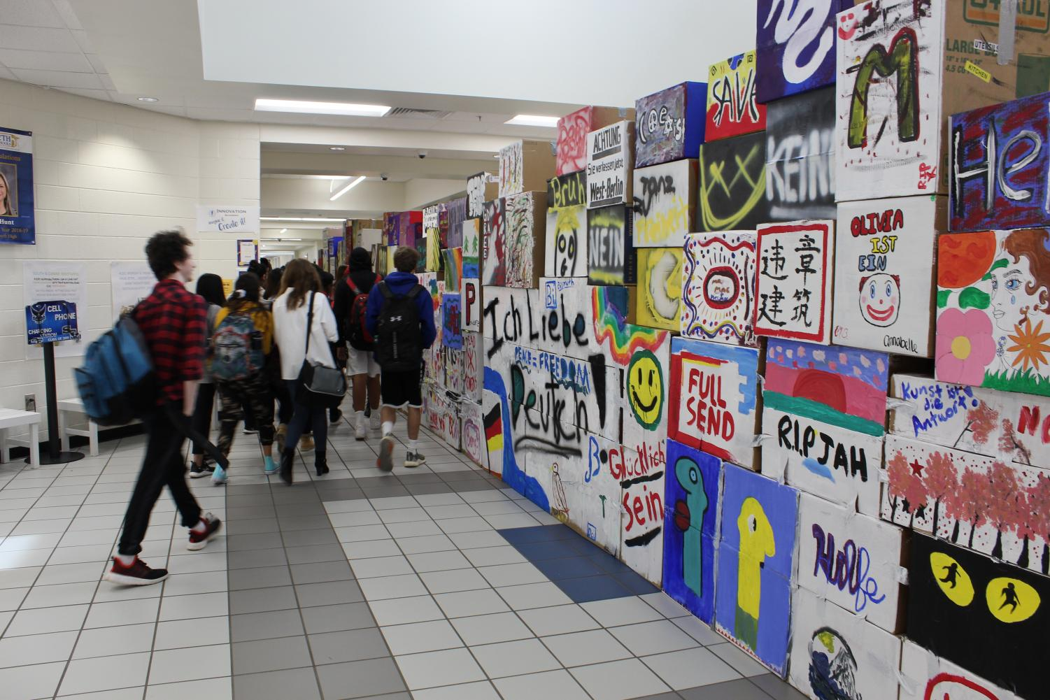 Walking the divide. In the main hall atrium, the SOFO German Students set up the wall. The point of this demonstration is to bring awareness to the Berlin Wall and how big of an impact it made by separating East and West Germany.