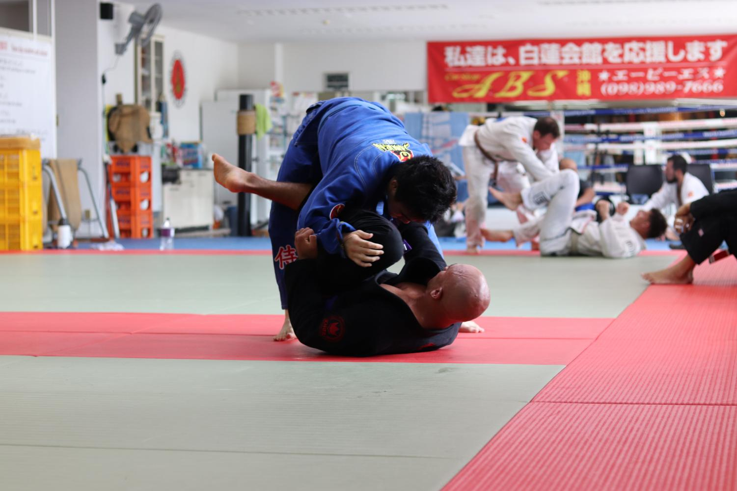 Athletes at play. The photo above is a representation of what the inside of a Krav Maga Studio may look like during a lesson. The Krav Maga program strives to combine ancient elements of self-defense along with  relevant strategies and techniques to combat possible targets.