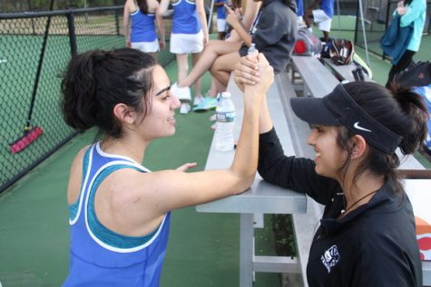 Victory. Varsity tennis player Mina Amirkhani puts much effort into her practices. Just like the South