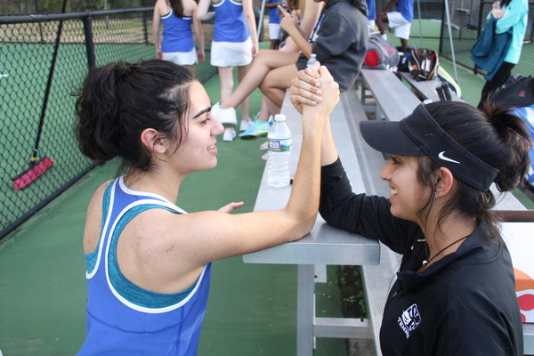 Victory. Varsity tennis player Mina Amirkhani puts much effort into her practices. Just like the South's tennis teams, her  goal for the year is to win the state medal during this year's championships.
