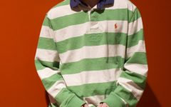 Artist photo. Robin Skinner poses in a green-stripped polo. Cavetown, Skinner's artist name, has gained over 250 million Spotify plays.