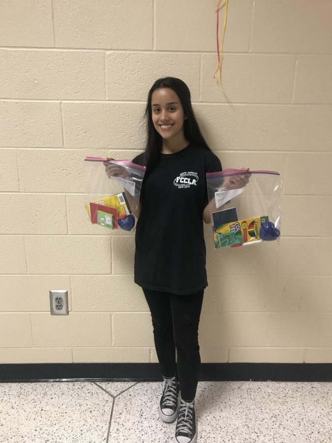 Bags of Love. Sophomore Kira Young displays the mental health kits that sparked her award-winning FCCLA project. They are meant to destress and uplift during a stressful time.