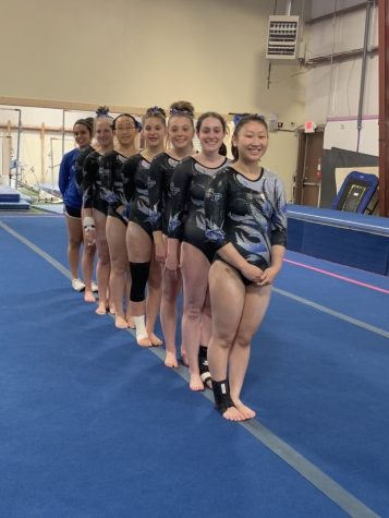 Let the games begin. The South Forsyth Varsity gymnastics team prepares to compete. Senior Sydney Goncalves, junior Emma Knezevich, freshman Abby Molish, freshman Alice Wang, freshman Carina Leftovits, sophomore Avery Sitko, senior Kelsey Watson, and sophomore Lia Carter, patiently awaited the start of the competition where they won second place.