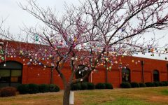 Easter is here. The West Hall tree is full of colorful eggs. The German students hand painted each egg and hung them up to celebrate the Easter season.