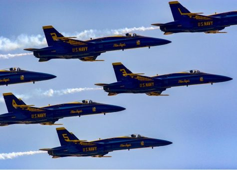The Blue Angels and Thunderbirds flying over Roswell, GA. Bystanders stood and stared up at the sky watching the planes overhead.