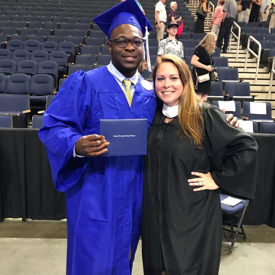 Senior students at last year's graduation file up along one another, eager to finally be able to claim their diplomas. Ms. Duff and one of her former students, Jamal, took one last photo together as she wishes him only the best for his future career ahead of him.