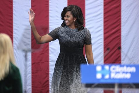 A room full of adoring fans. As Michelle Obama walks on to the stage with a huge smile on her face, she waves to the audience as she walks up to the podium. Former first lady has experience in public speaking and continues to display those skills. Like during this virtual democratic national convention.