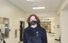 Unique patterns. Cody Strozensky, a student at South Forsyth High School, wears a black uniquely patterned mask with a dark hoodie. With the pandemic, students have been seen with some pretty unique and colorful masks.