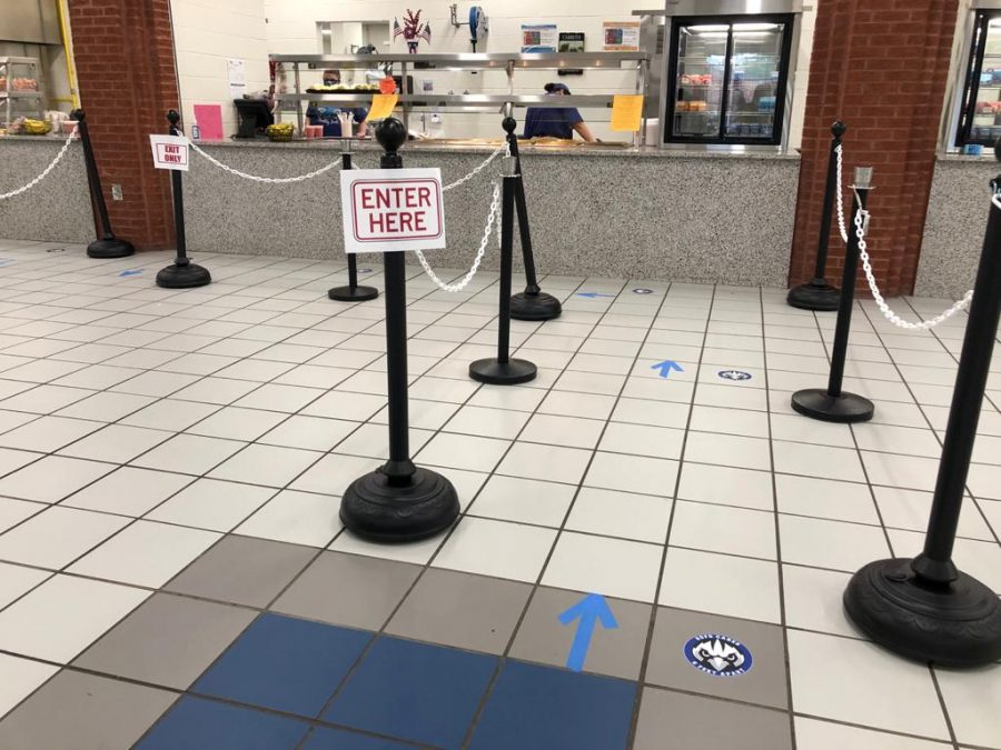 Distancing during lunch. As students come to the dining hall during lunch, there are many new procedures to ensure that each student is safe. For example, as a student is waiting in line, they are spaced out from those around them to be safe.