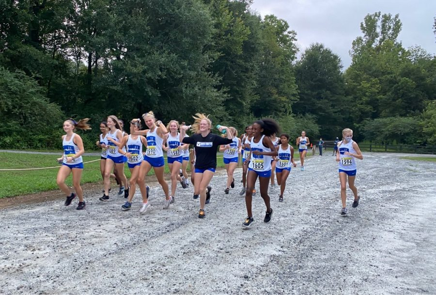 South girls. South Forsyth Cross- country girls warm-up, and are getting ready to race. Seniors Megan Milstead and Madi Butler hype the team up with music, and get in the groove of racing in South's first meet. This past weekend, the Lambert Tri-meet was hosted at Chattahoochee Pointe Park.