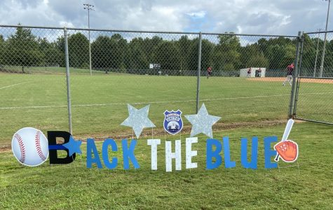 Back the Blue. Five teams from all over the county competed in a softball tournament supporting first responders in Forsyth County. Teachers and staff from schools in the county came together to support first responders. Three teachers and softball coaches from South, Coach Brooks, Coach Weber, and Coach Pearson, competed in this tournament.