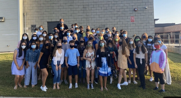 Band pride. South's band takes pictures together outside with masks to follow guidelines. Even though COVID has affected them, our band stayed strong and connected through these times.